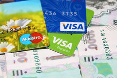 Visa cards and Maestro on a background of money royalty free stock photo
