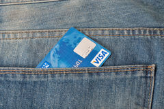 Visa credit card in pocket of blue jeans closeup Royalty Free Stock Photo
