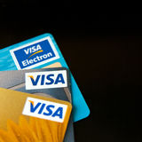 Visa credit cards. Collection of Visa credit cards, including Visa Electron, isolated on black background Stock Photos