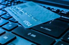 Visa Credit Cards over keyboard Stock Photo