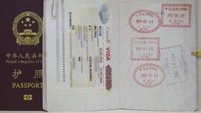 VISA de Canadá y pasaporte de China foto de archivo