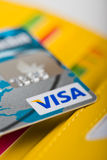 Visa Debit Card  in wallet and other cards. Royalty Free Stock Photo