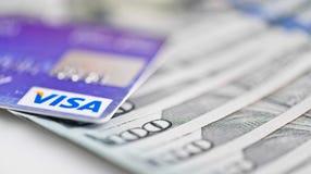 Visa Debit Cards Over Dollar bills Royalty Free Stock Image