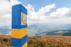 Visa-free regime concept. Border pillar on Ukrainian frontier at Carpatian montain. Ukraine got free visa travel status Royalty Free Stock Images