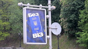 Visa free travel for Ukrainian citizens placard in Kiev, Ukraine stock footage
