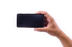 Visa handen på den smarta telefonen Royaltyfria Bilder