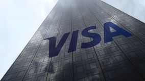 Visa Inc. logo on a skyscraper facade reflecting clouds, time lapse. Editorial 3D rendering. Visa Inc. logo on a skyscraper facade reflecting clouds, time lapse stock video
