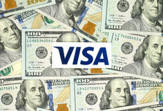 Visa logo printed on paper and placed on money background Stock Images