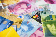 Visa and MasterCard credit cards on Swiss banknotes. Royalty Free Stock Photo