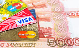 VISA and Mastercard Debit Card with russian rubles Royalty Free Stock Image