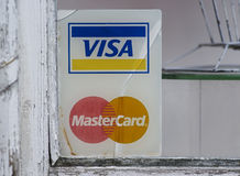 VISA and Mastercard fading signs Royalty Free Stock Image