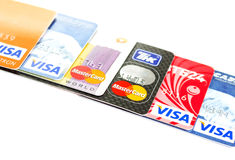 Visa and Mastercard. Moscow, Russian Federation - June 07, 2015: Heap of credit cards with Visa and Mastercard logos on white background. Visa and Mastercard are royalty free stock image