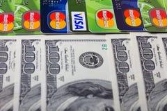 Visa and MasterCard, with US dollar bills Stock Photos