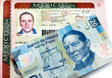 Visa of Mexico in the Russian international passport and Mexican pesos Royalty Free Stock Photography
