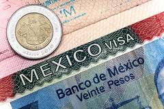 The visa of Mexico in the Russian international passport and Mexican pesos.  Stock Photo