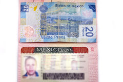 Visa of Mexico in the Russian international passport and Mexican pesos Stock Image