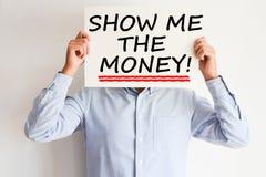 Visa mig pengartexten som är skriftlig på pappers- kort Arkivbild