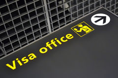 Visa office direction sign, airport, travel diversity Stock Photos