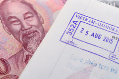 Visa passport stamp from vietnam and Vietnamese money (Dong) Stock Photos