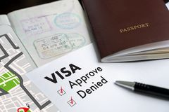 Visa and passport to approved stamped on a document top view in stock photo