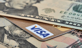 Visa. Saratov, Russian Federation - September 21, 2014: Background of cash dollars and Visa credit card stock image
