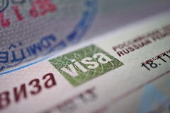 Visa sign in golden emblem as part of Russian Visa page Stock Photography