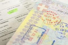 Visa stamp. Passport with visa stamps with eticket Royalty Free Stock Photo