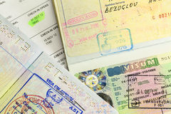 Visa stamp. Passports with cuba, schengen and thailand visa stamps Stock Image
