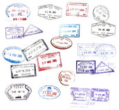 Visa stamps. Various visa stamps from passports from worldwide travelling Royalty Free Stock Photo