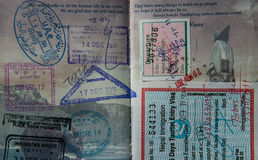 Visa stamps in an American passport. Two pages of visa stamps in a United States passport Stock Images