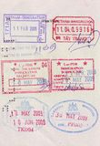 Visa stamps on passport. Of entry and exit of many countries Royalty Free Stock Photography