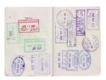 Visa stamps on passport. Of entry and exit of many countries..Isolated on white background Royalty Free Stock Photo