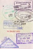 Visa stamps on passport. Of entry and exit of many countries Royalty Free Stock Image