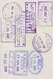 Visa stamps on passport. Of entry and exit of many countries Stock Images