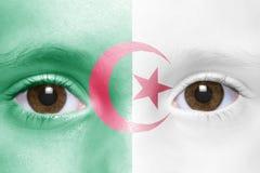 Visage avec le drapeau algérien Photo libre de droits