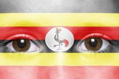 Visage avec le drapeau d'ugandan Photographie stock