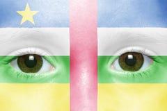 Visage avec le drapeau de la république centrafricaine Image libre de droits