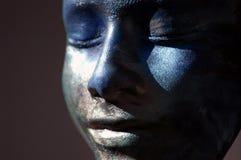 Visage bleu d'argile Photographie stock libre de droits