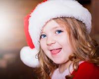 Visage, chapeau de Noël ! Photographie stock libre de droits