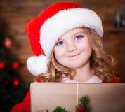 Visage, chapeau de Noël, cadeau ! Image stock