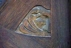 Visage découpé en bois symbolisant le vent photographie stock libre de droits