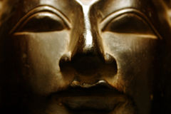 Visage d'or de Bouddha Photos stock