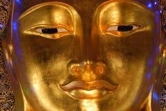 Visage d'or de Bouddha Photographie stock