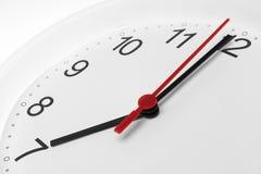 Visage d'horloge avec du temps fonctionnant à sept Image stock