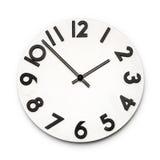 Visage d'horloge blanc d'isolement avec des nombres noirs Photos stock