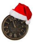 Visage d'horloge et chapeau de Santa Claus, d'isolement sur le fond blanc Photo libre de droits