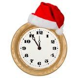 Visage d'horloge et chapeau de Santa Claus, d'isolement sur le fond blanc Image libre de droits