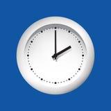 Visage d'horloge sur un fond bleu Image libre de droits