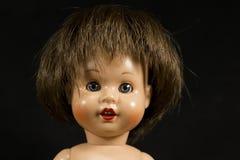 Visage d'une poupée image stock