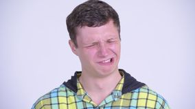 Visage de jeune homme semblant triste et bouleversé clips vidéos